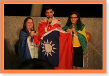 photo: Three foreign students hold national flag of Taiwan.